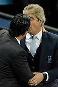 Manchester City manager Manuel Pellegrini and Sevilla  manager Unai Emery get friendly during the Champions League Group D match between Manchester City and Sevilla at the Etihad Stadium, Manchester, England on 21 October 2015. Photo by Alan Franklin.