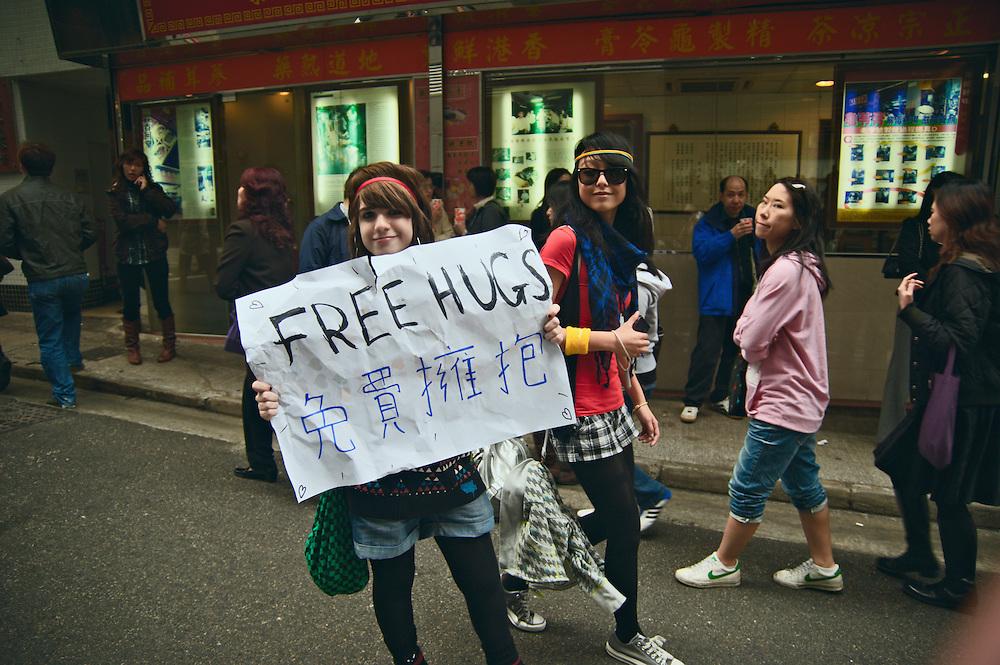 "Girls with ""free hugs"" sign, Stanley Street, Hong Kong"