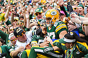 GREEN BAY, WI - SEPTEMBER 15:  Jordy Nelson #87 of the Green Bay Packers leaps into the stands after a touchdown catch against the Washington Redskins at Lambeau Field on September 15, 2013 in Green Bay, Wisconsin.  The Packers defeated the Redskins 38-20.  (Photo by Wesley Hitt/Getty Images) *** Local Caption *** Jordy Nelson