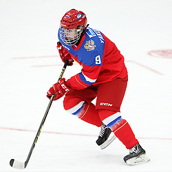 COBOURG, - Dec 19, 2015 -  Gold Metal Game - Russia vs Canada West at the 2015 World Junior A Challenge at the Cobourg Community Centre, ON. Aleksandr Iakovenko #9 of Team Russia skates with the puck during the second period.(Photo: Tim Bates / OJHL Images)