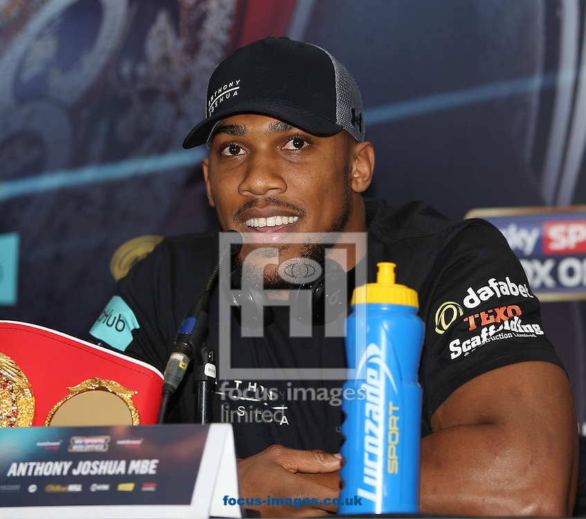 Anthony Joshua pictured with his IBF World Heavyweight title during the Joshua Molina press conference, prior to their IBF Heavyweight title fight this weekend, at Radisson Blu Edwardian Hotel, Manchester<br /> Picture by James Wilson/Focus Images Ltd 07709 548263<br /> 08/12/2016