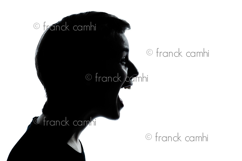 one caucasian young teenager silhouette boy or girl laughing portrait in studio cut out isolated on white background