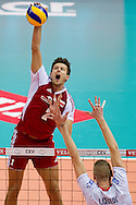 (L) Jakub Winiarski from Poalnd attacks against (R) Kevin Le Roux from France during the 2013 CEV VELUX Volleyball European Championship match between Poland and France at Ergo Arena in Gdansk on September 21, 2013.<br /> <br /> Poland, Gdansk, September 21, 2013<br /> <br /> Picture also available in RAW (NEF) or TIFF format on special request.<br /> <br /> For editorial use only. Any commercial or promotional use requires permission.<br /> <br /> Mandatory credit:<br /> Photo by © Adam Nurkiewicz / Mediasport