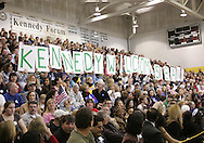 "10 February 2007: People hold up a sign that says ""Kennedy Welcomes Obama"" as Democratic presidential hopeful Senator Barack Obama (D-IL) arrives to speak at a town hall meeting at Kennedy High School in Cedar Rapids, Iowa on February 10, 2007."
