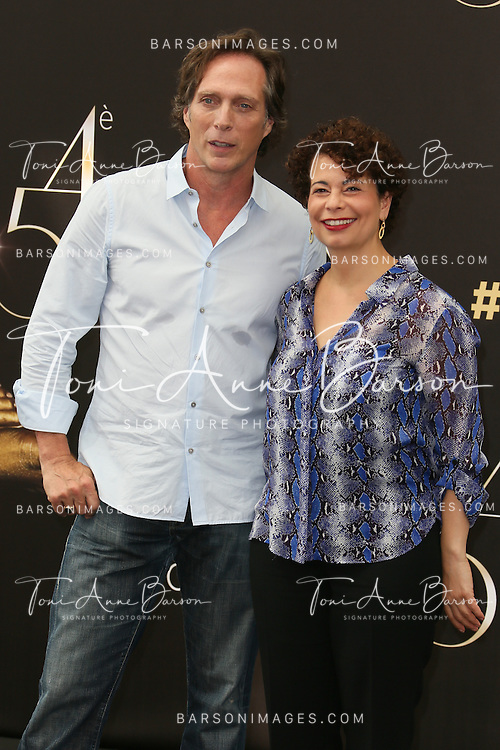 "MONTE-CARLO, MONACO - JUNE 10: William Fichtner and Rola Bauer attend ""Crossing Lines"" Photocall at the Grimaldi Forum on June 10, 2014 in Monte-Carlo, Monaco.  (Photo by Tony Barson/FilmMagic)"