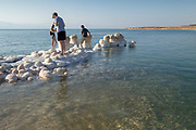 Israel, Dead Sea, salt crystalization caused by water evaporation. A group of photographers photographing the scene