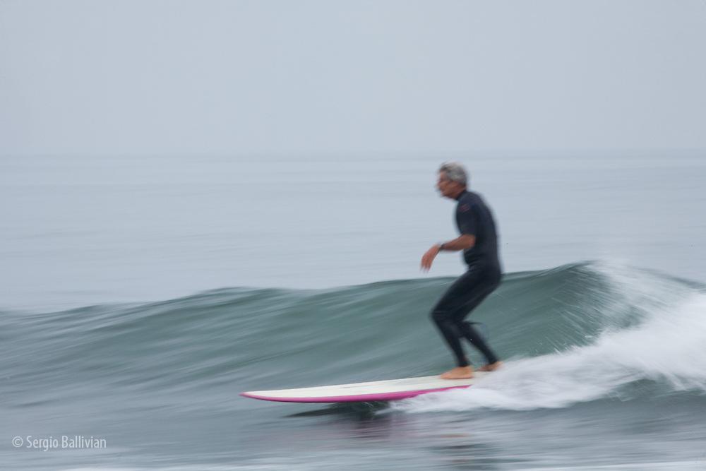 Surfers enjoying the early morning waves at Topanga Beach, CA