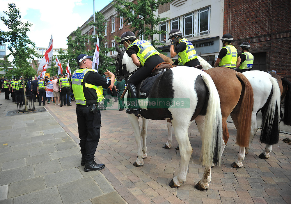 Police in Nottingham city centre as they monitor protesters from the English Defence League (EDL).