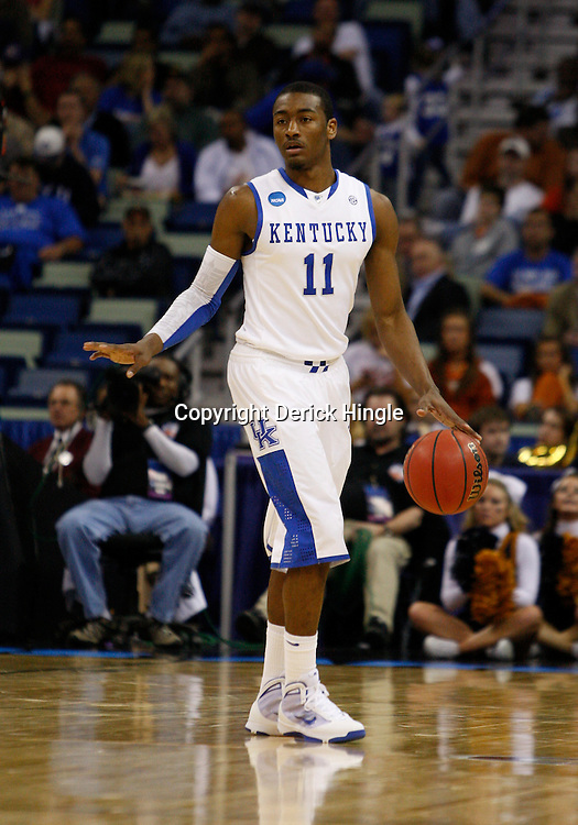Mar 18, 2010; New Orleans, LA, USA; Kentucky Wildcats guard John Wall (11) drives with the ball against the East Tennessee State Buccaneers during the second half in the first round of the 2010 NCAA mens basketball tournament at New Orleans Arena.  Kentucky defeated East Tennessee State 100-71. Mandatory Credit: Derick E. Hingle-US PRESSWIRE