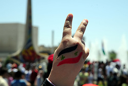DAMASCUS, April 16, 2018  A Syrian makes a victory sign during a pro-government rally held at the Umayyad Square, in Damascus, Syria, on April 16, 2018. Thousands of Syrians in Damascus thronged the Umayyad Square celebrating the military victory in Eastern Ghouta despite the U.S.-led attack on Syrian military positions.   zf) (Credit Image: © Ammar Safarjalani/Xinhua via ZUMA Wire)