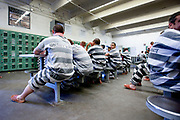 Inmates in the Tent Prison, a part of the Maricopa County Jail where prisoners are serving time for minor offences and where undocumented are detained until they are expelled from the US. In the often sweltering heat of Arizona, inmates dressed in pink underwear and black and white prison outfit are sleeping outdoors in huge military style tents. The inmates are only served two meals a day, consisting of leftovers from rescued food. The harsh prison conditions was only one of many controversial punitive actions in the sheriff's bid to be tough on crimes. A staunch republican and media savvy, Joe Arpaio was reelected several times before being replaced in 2017 by Sheriff Paul Perzone.