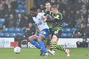 Bury Midfielder, Rohan Ince (30) adn Doncaster Rovers Midfielder, Tommy Rowe (10) during the EFL Sky Bet League 1 match between Bury and Doncaster Rovers at the JD Stadium, Bury, England on 28 October 2017. Photo by Mark Pollitt.