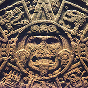 MEXICO CITY, MEXICO--Believed to date to the early 16th century or late 15th century, the Stone of the Sun is a large disc nearly 12 feet across and weighing 24 tons. Discovered in 1790 in the Plaza Mayor, the Stone of the Sun was originally misidentified as the Aztec Calendar. It has more recently been identified as a large gladiatorial sacrificial altar, known as a temalacatl. It was not finished because of a deep crack that runs from one side to the center of the piece at the rear. Despite the fracture, it was used to stage the fights between warriors in the tlacaxipehualiztli ceremony. It is on display as one of the most famous pieces in the National Museum of Anthropology in Mexico City. The National Museum of Anthropology showcases  significant archaeological and anthropological artifacts from the Mexico's pre-Columbian heritage, including its Aztec and indiginous cultures.