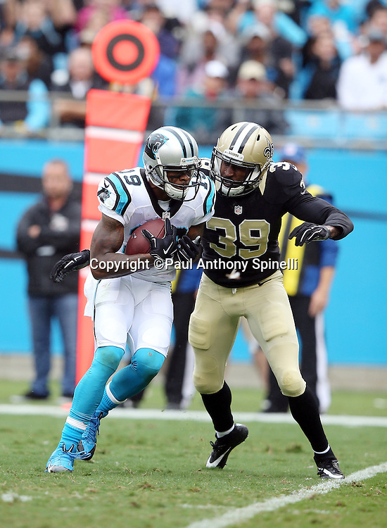 Carolina Panthers wide receiver Ted Ginn, Jr. (19) catches a 15 yard pass for a second quarter first down as he gets tackled by New Orleans Saints cornerback Brandon Browner (39) during the 2015 NFL week 3 regular season football game against the New Orleans Saints on Sunday, Sept. 27, 2015 in Charlotte, N.C. The Panthers won the game 27-22. (©Paul Anthony Spinelli)