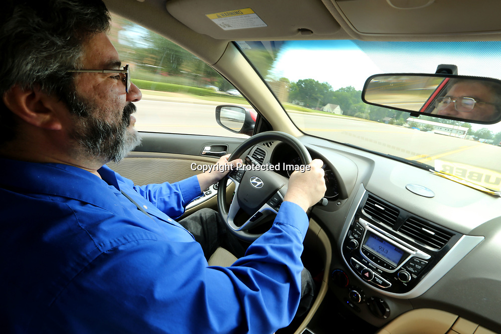 Carlos Diaz, an UBER driver, drives east on Main Street in Tupelo on Wednesday afternoon.
