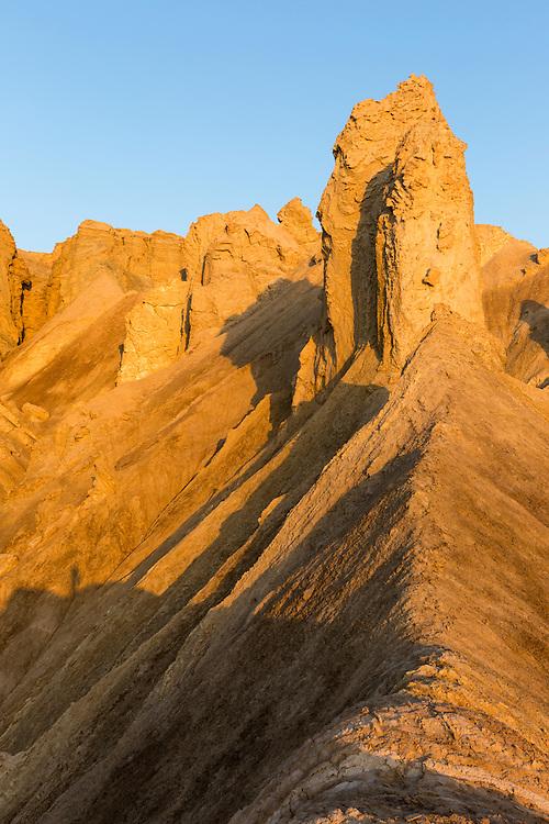 Israel, Morning sun lights jagged cliffs in Judean Desert above Dead Sea near Ein Gedi