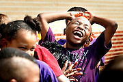 May 9, 2013 - Second grader Jordan James can't resist the temptation to squeeze a soaked sponge on his head while playing a water game on Thursday. Students from  Rivercrest Elementary School in Bartlett enjoyed a variety of outdoor activities for field day, which has been indoors previously. The school moved the event outside so that they could play some new games, including sack races and water games.    (Karen Pulfer Focht/ The Commercial Appeal)