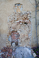 View of damaged stone wall