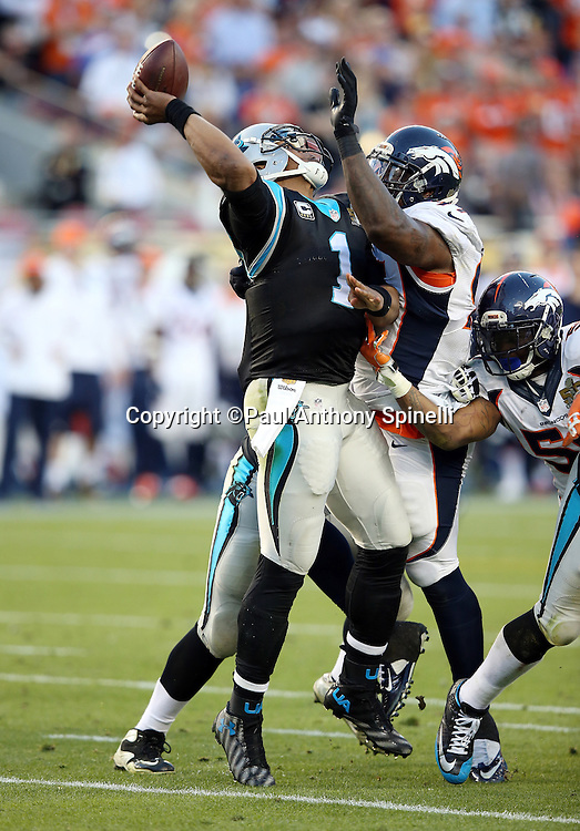 Carolina Panthers quarterback Cam Newton (1) throws an incomplete second quarter pass due to pressure on a second quarter hit by Denver Broncos defensive end Malik Jackson (97) during the NFL Super Bowl 50 football game against the Denver Broncos on Sunday, Feb. 7, 2016 in Santa Clara, Calif. The Broncos won the game 24-10. (©Paul Anthony Spinelli)