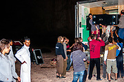People removing sound equipment from a lorry at Middle East Tek, Wadi Rum, Jordan, 2008