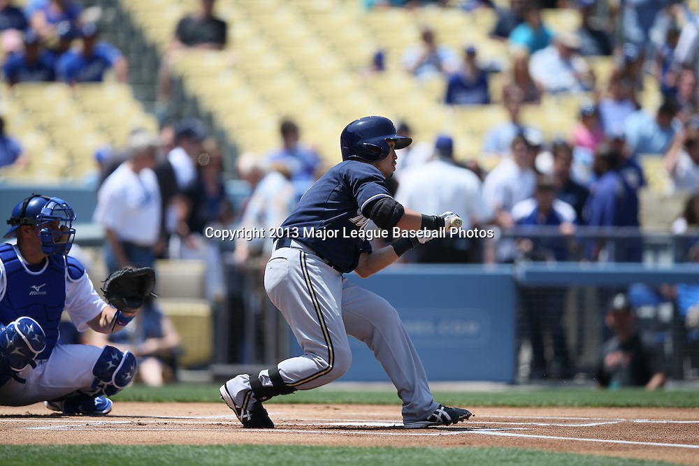 LOS ANGELES, CA - APRIL 28:  Norichika Aoki #7 of the Milwaukee Brewers attempts a bunt during the game against the Los Angeles Dodgers on Sunday, April 28, 2013 at Dodger Stadium in Los Angeles, California. The Dodgers won the game 2-0. (Photo by Paul Spinelli/MLB Photos via Getty Images) *** Local Caption *** Norichika Aoki