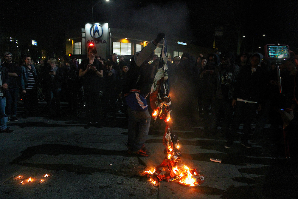 Protester burning an American flag during a protest in Oakland, CA December 2014.