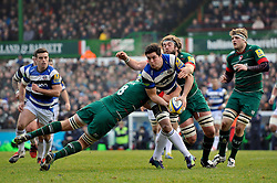 Francois Louw of Bath Rugby looks to offload the ball after being tackled - Photo mandatory by-line: Patrick Khachfe/JMP - Mobile: 07966 386802 04/01/2015 - SPORT - RUGBY UNION - Leicester - Welford Road - Leicester Tigers v Bath Rugby - Aviva Premiership