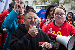 London, UK. 12 November, 2019. Isaías Marcelino Sapon, a McDonald's worker, of Houston Fight for $15, addresses McDonald's workers belonging to the Bakers Food & Allied Workers Union (BFAWU) assembled opposite Downing Street during strike action, dubbed a 'McStrike', to call for a New Deal for McDonald's Workers which would include £15 an hour, an end to youth rates, the choice of guaranteed hours of up to 40 hours a week, notice of shifts four weeks in advance and union recognition.