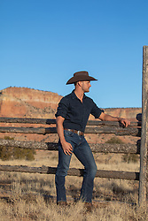 hot rugged cowboy on a ranch