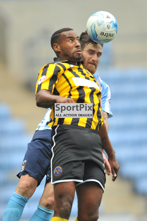 Coventrys Romain Vincelot Holds of Shrewsburys Tyrone Barnett, Coventry City v Shreswsbury Ricoh Arena, Football League One, Saturday 3rd October 2015