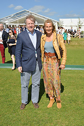 The HON.CHARLES & MRS PEARSON at the St.Regis International Polo Cup at Cowdray Park, Midhurst, West Sussex on 16th May 2015.