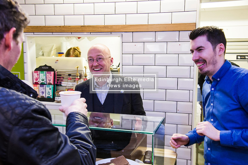 Pictured: Patrick Harvei and manager Leo Smith<br /> <br /> Greens co-cordinator Partrick Harvie headed to Rose Street in Edinburgh today to serve customers at Social Bite cafe, a social enterprise supporting the homeless<br /> <br /> Ger Harley   EEm 20 April 2016