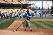 LOS ANGELES, CA - APRIL 28:  The grounds crew wrakes home plate before the Los Angeles Dodgers game against the Milwaukee Brewers on Sunday, April 28, 2013 at Dodger Stadium in Los Angeles, California. The Dodgers won the game 2-0. (Photo by Paul Spinelli/MLB Photos via Getty Images)