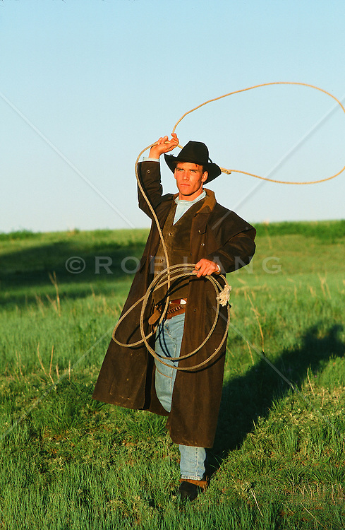 All American cowboy with a lasso outdoors