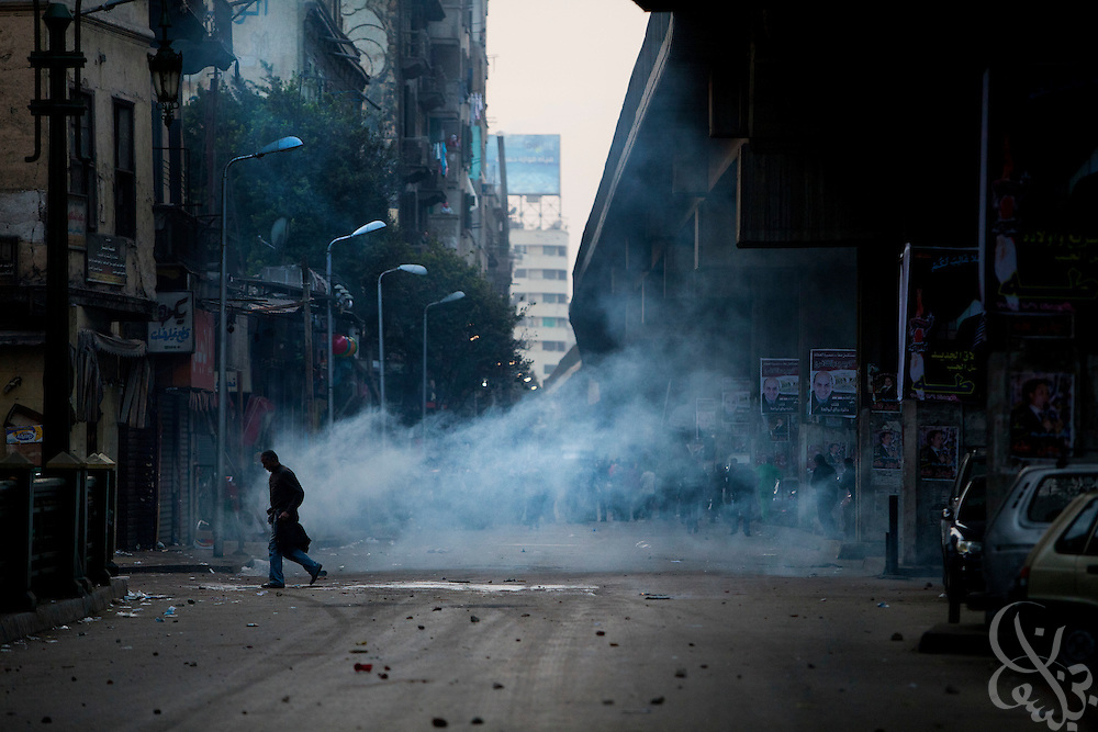 An Egyptian man crosses through a cloud of tear gas fired by Egyptian riot police during continuing January 26, 2011 demonstrations in downtown Cairo, Egypt. A series of unprecedented demonstrations have broken out across Egypt for the past two days, inspired by the revolution in Tunisia, and intended to spark a similar movement in Egypt. (Photo by Scott Nelson)
