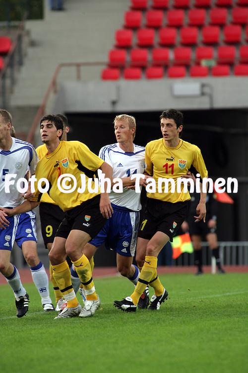 07.09.2005, Ratina Stadium, Tampere, Finland..FIFA World Cup 2006 Qualifying Match, .Finland v FYR Macedonia.Toni Kuivasto (Finland) v Goran Maznov (Macedonia).©Juha Tamminen.....ARK:k