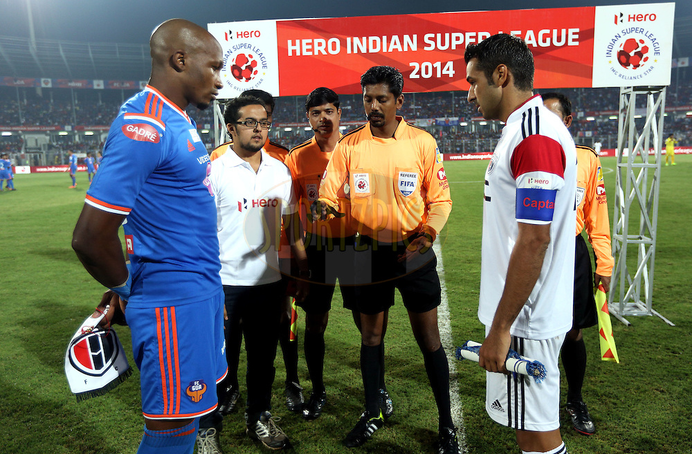 Gregory Arnolin of FC Goa and NorthEast United FC captain Miguel Garcia during the toss of the match 46 of the Hero Indian Super League between FC Goa and North East United FC held at the Jawaharlal Nehru Stadium, Fatorda, India on the 1st December 2014.<br /> <br /> Photo by:  Sandeep Shetty/ ISL/ SPORTZPICS