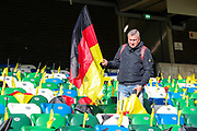 A German supporter lays out flags for the visiting fans ahead of the UEFA European 2020 Qualifier match between Northern Ireland and Germany at National Football Stadium, Windsor Park, Northern Ireland on 9 September 2019.