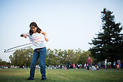 Chloe Chico, 10, of San Jose hula hoops during the National Night Out event at Berryessa Creek Park in San Jose, California, on August 5, 2014. (Stan Olszewski/SOSKIphoto)