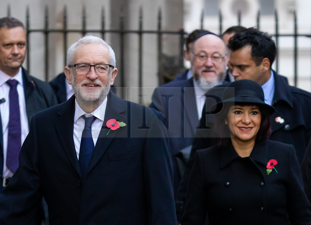 © Licensed to London News Pictures. 26/11/2019. London, UK. FILE PICTURE. Leader of the Labour Party, Jeremy Corbyn (L) and his wife, Laura Alvarez (R) with Chief Rabbi Ephraim Mirvis (back 2-R) walk through Downing Street to attend the Remembrance Sunday Ceremony at the Cenotaph in Whitehall on 10th November 2019. Chief Rabbi Ephraim Mirvis yesterday spoke to criticise anti-Semitism in the Labour Party, including an alleged 130 cases of anti-semitism that have not been dealt with. Mr Corbyn will launch his party's 'race and faith manifesto' this morning, which includes a plan to hold an inquiry into far-Right extremism. Photo credit: Vickie Flores/LNP