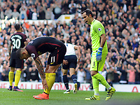 Football - 2016 / 2017 Premier League - Tottenham Hotspur vs Manchester City<br /> <br /> Aleksandar Kolarov of Manchester City shows his dejection after putting the ball into his own net for Tottenham's first goal as Claudio Bravo comes over to him at White Hart Lane<br /> <br /> Credit : Colorsport / Andrew Cowie