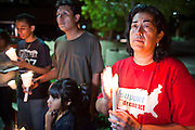 "Sept. 19 - PHOENIX, AZ: Families in support of the DREAM Act at a candlelight vigil in front of Sen. John McCain's office in Phoenix Sunday night. About 30 people met in front of US Sen. John McCain's office in Phoenix Sunday night to demonstrate in support of the DREAM Act, which is scheduled to be debated in the US Senate on Tuesday, Sept 21. The Development, Relief and Education for Alien Minors Act (The ""DREAM Act"") is a piece of proposed federal legislation in the United States that was introduced in the United States Senate, and the United States House of Representatives on March 26, 2009. This bill would provide certain illegal immigrant students who graduate from US high schools, who are of good moral character, arrived in the U.S. as minors, and have been in the country continuously for at least five years prior to the bill's enactment, the opportunity to earn conditional permanent residency. In the early part of this decade McCain supported legislation similar to the DREAM Act, but his position on immigration has hardened in the last two years and he no longer supports it. The protesters, mostly area students, marched and drilled to show their support for the US military and then held a candle light vigil.   Photo by Jack Kurtz"