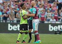 Football - 2016 / 2017 Premier League - West Ham United vs. AFC Bournemouth<br /> <br /> Bournemouth's Jordon Ibe squares up to James Collins of West Ham at The London Stadium.<br /> <br /> COLORSPORT/DANIEL BEARHAM