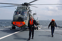 09 AUG 2001, BERLIN/GERMANY:<br /> Rudolf Scharping, SPD, Bundesverteidigungsminister, waehrend einem Besuch von Marineeinheiten im Seegebiet vor Rostock, hier mit Schwimmweste nach der Landung mit einem SEA KING Hubschrauber (SAR Rettungshubschrauber) auf dem Tender DONAU<br /> IMAGE: 20010809-01-002<br /> KEYWORDS: Bundeswehr, Bundesmarine, Marine