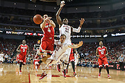 January 20, 2014: Mike Peltz (12) of the Nebraska Cornhuskers dives in front of teammate Leslee Smith (21) of the Nebraska Cornhuskers to foul Aaron Craft (4) of the Ohio State Buckeyes at the Pinnacle Bank Arena, Lincoln, NE. Nebraska won in the game against Ohio State 68 to 62.