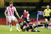 Ospreys wing Keelan Giles gathers the ball, watched by Stade Francais full-back Hugo Bonneval during the European Challenge Cup match between Ospreys and Stade Francais at Principality Stadium, Cardiff, Wales on 2 April 2017. Photo by Andrew Lewis.