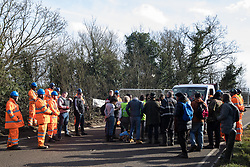 Harefield, UK. 8 February, 2020. Environmental activists block a HS2 vehicle on Harvil Road in the Colne Valley during action to prevent tree felling works for the high-speed rail project. Environmental activists based at a series of wildlife protection camps in the area used a variety of tactics to prevent the tree felling work, for which road and rail closures had been implemented, for the duration of the weekend for which it had been scheduled.