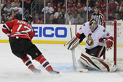 Apr 7; Newark, NJ, USA; Ottawa Senators goalie Craig Anderson (41) makes a save on New Jersey Devils left wing Ilya Kovalchuk (17) during the first period at the Prudential Center.