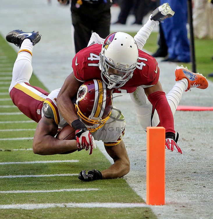 Arizona Cardinals cornerback Marcus Cooper (41) stops Washington Redskins wide receiver Ryan Grant short of the goal line during the first half of an NFL football game, Sunday, Dec. 4, 2016, in Glendale, Ariz. (AP Photo/Rick Scuteri)