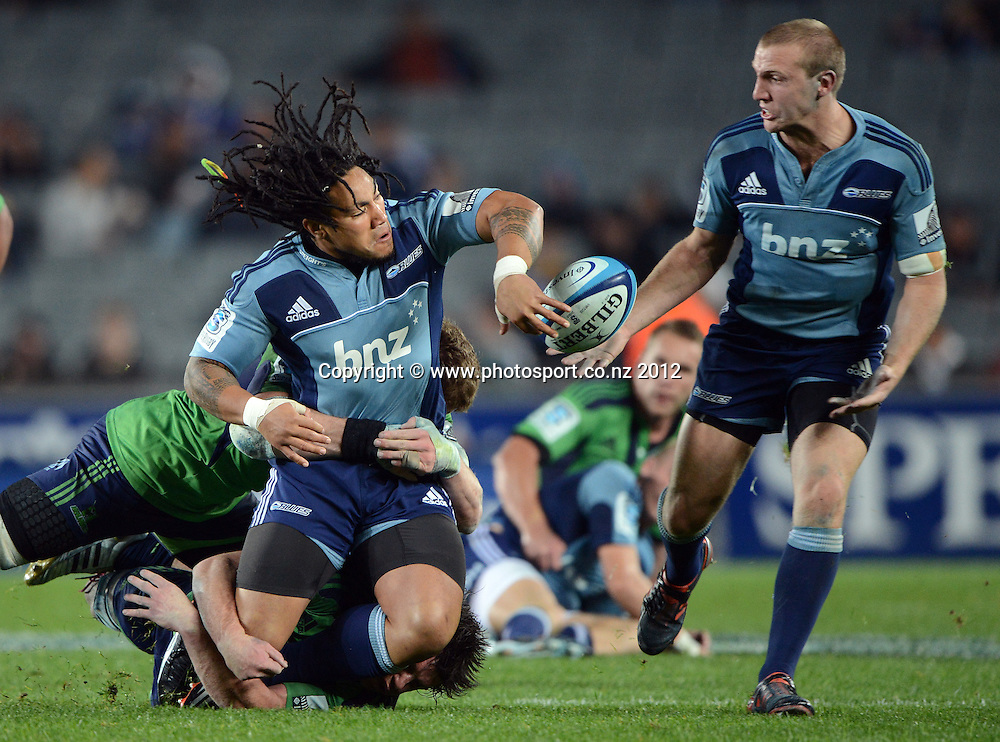 Ma'a Nonu gets his pass away to Hadleigh Parkes during the Blues and Highlanders at Eden Park, Auckland, New Zealand on Saturday 26 May 2012. Photo: Andrew Cornaga/Photosport.co.nz